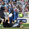New Zealand's Brendon McCullum slides in as India's