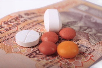 OTC drugs resting on top of Indian money