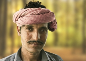 An Indian man wearing a pink turban