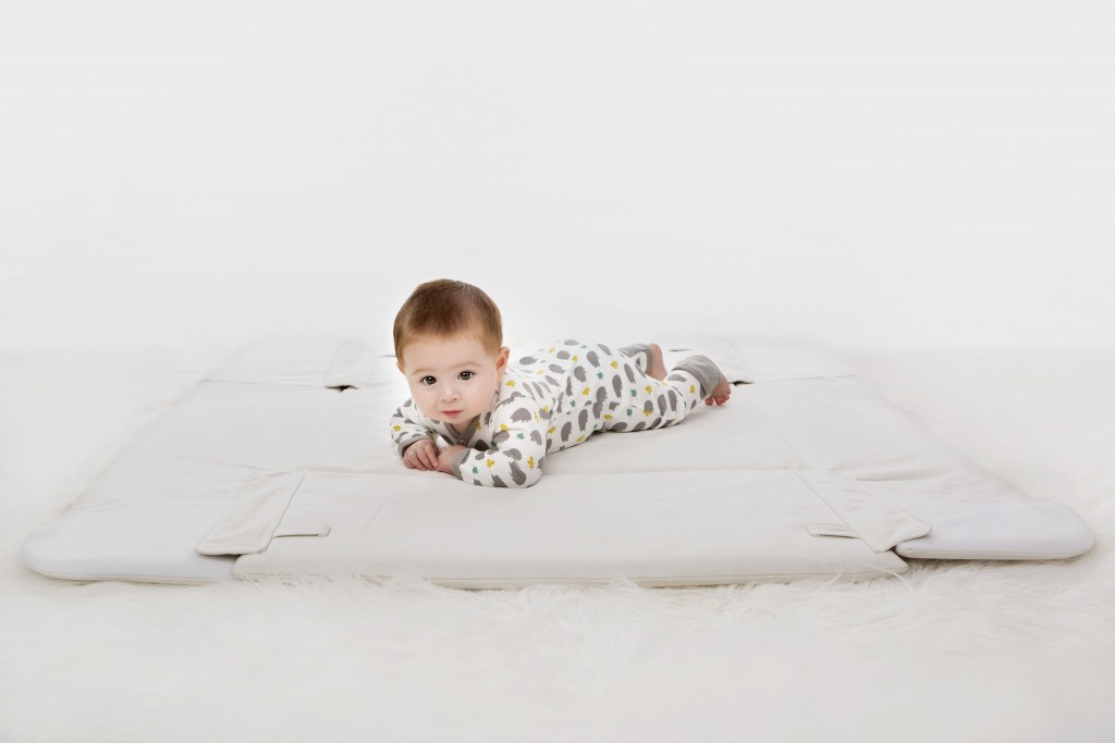 singapores-child-baby-playing-lying-on-play-mat-angel-babybox-floor-cute