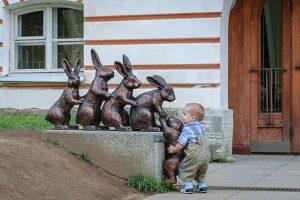 6-Young Kid Helps Bunny Climb Sculpture