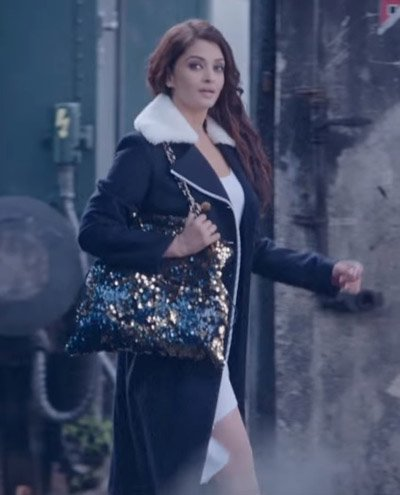 Aishwarya Rai Bachchan in a white short dress, black overcoat and shimmer bag in Ae Dil Hai Mushkil.jpg