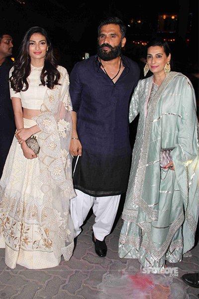 Athiya Shetty with parents Suniel and Mana at Amitabh Bachchan Diwali party 2016.jpg