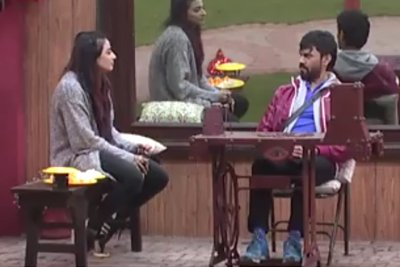 Gaurav Chopra peddling the machine with VJ Bani for company - Bigg Boss 10.jpg