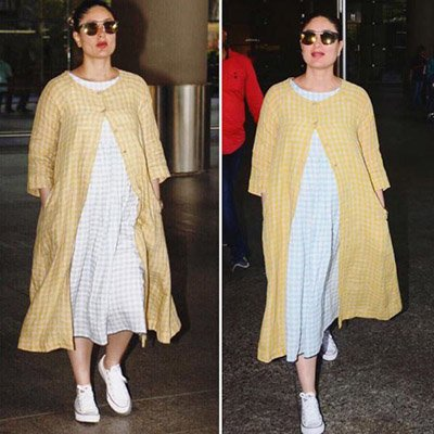 Kareena Kapoor Khan in a orange checked jacket at the airport.jpg