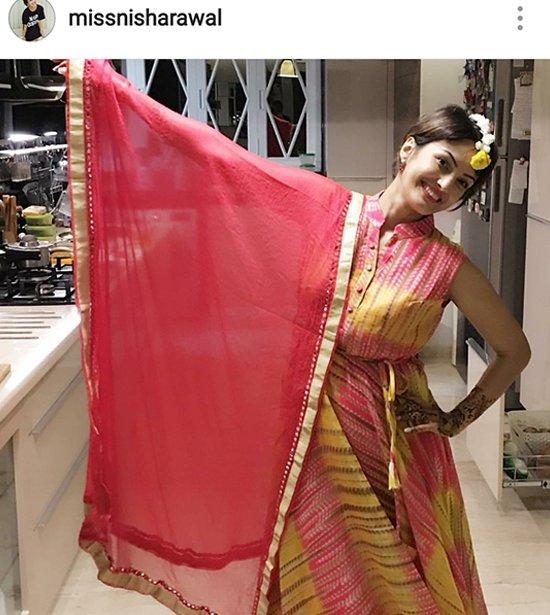 Nisha Raval Mehra showing off her dress.jpg