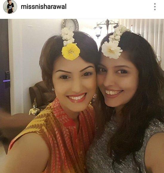 Nisha Raval Mehra with a friend.jpg