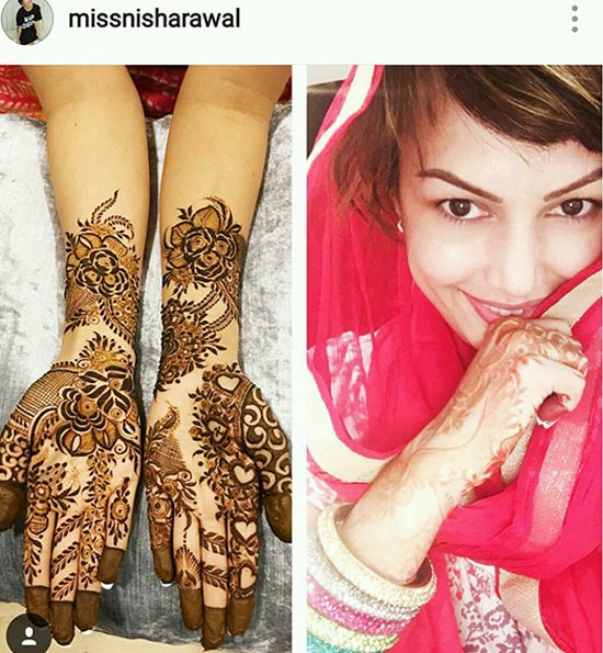 Nisha Raval shows off her mehendi design.jpg