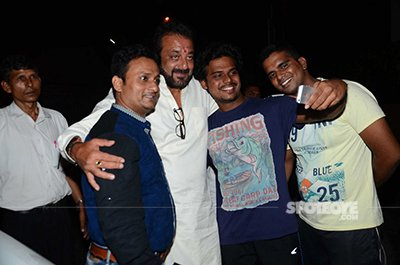 Sanjay Dutt also obliged his fans standing to get a glimpse of him.jpg