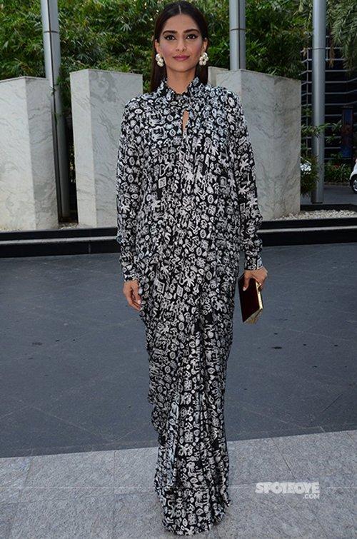 Sonam Kapoor wears a black dress.jpg