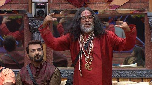 Swami Omji does the yo sign in Bigg Boss 10 house.jpg
