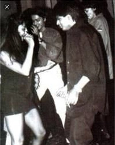 young Shah Rukh Khan and Gauri Khan dancing together during a party 1.jpg