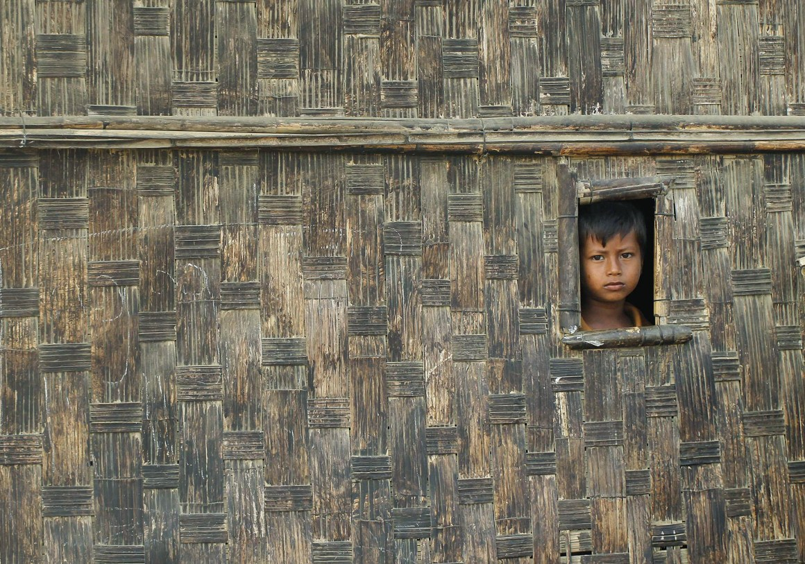 A boy looks from his temporary shelter at a Rohingya refugee camp as Myanmar's government embarks on a national census, in Sittwe