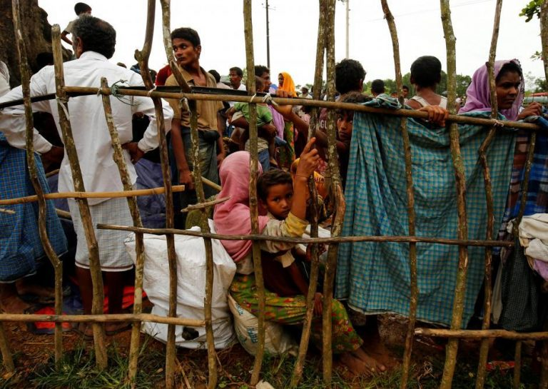 New Rohingya refugees wait to enter the Kutupalang makeshift refugee camp, in Cox's Bazar, Bangladesh, August 30, 2017. REUTERS/Mohammad Ponir Hossain