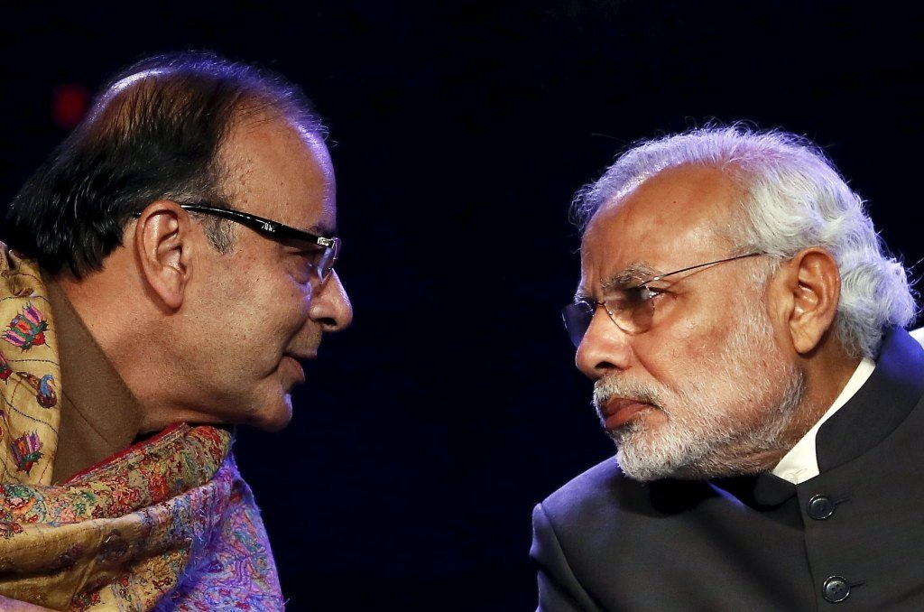 File photo of Indian PM Modi listening to FM Jaitley during the Global Business Summit in New Delhi