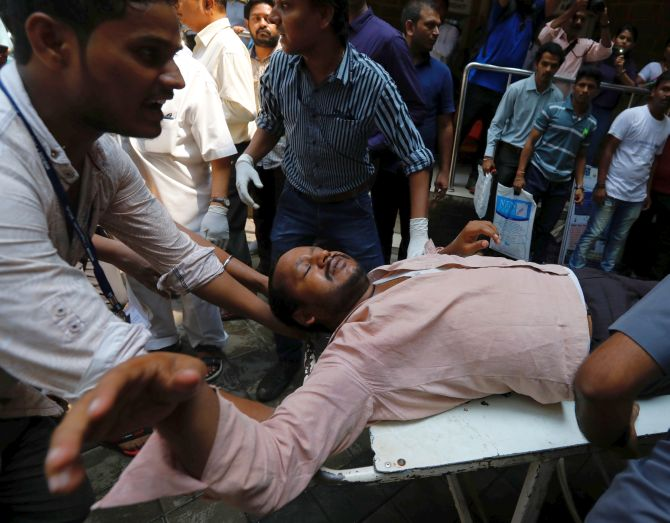 A stampede victim is carried on a stretcher at a hospital in Mumbai