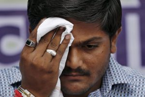 Patel wipes his face during a news conference in New Delhi