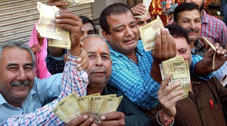 Jammu: Vaishno Devi pilgrims showing demonetized 500 and 1000 rupees notes in Jammu on Wednesday. PTI Photo (PTI11_9_2016_000308A)