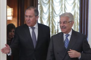 Russian Foreign Minister Sergei Lavrov, left, shows the way to his Pakistani counterpart Khawaja Asif during a meeting in Moscow