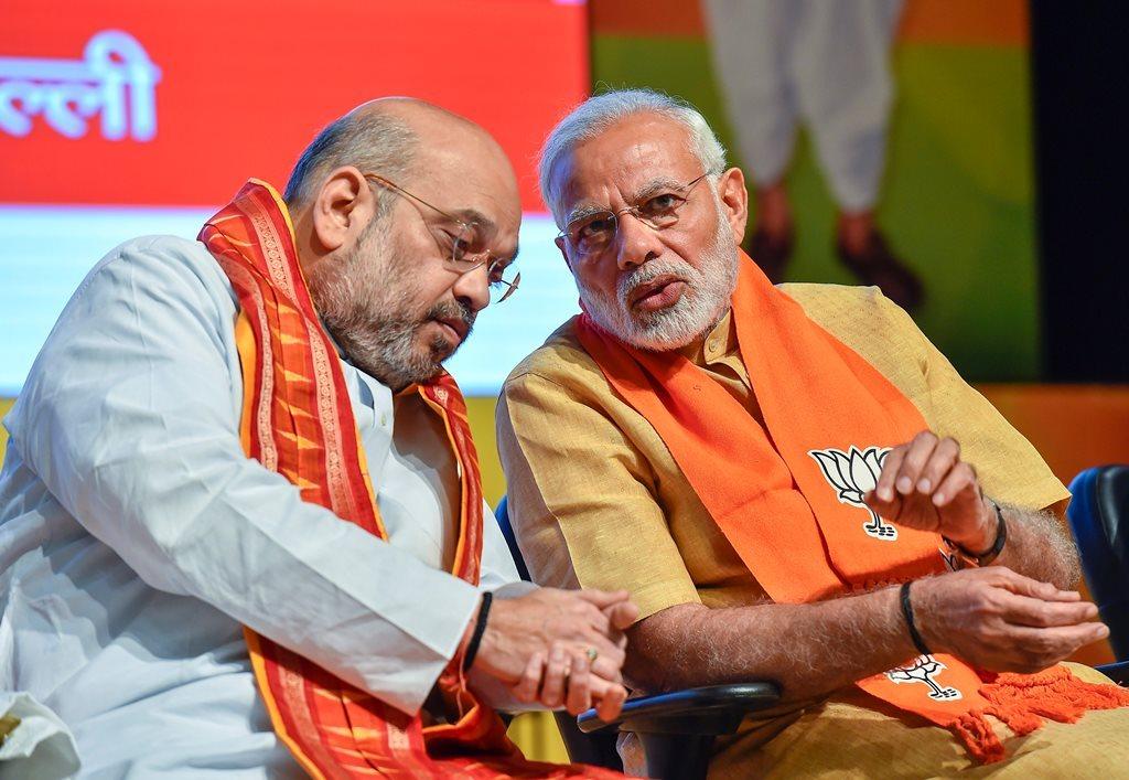 وزیر اعظم نریندر مودی اور بی جے پی کے صدر امت شاہ (فوٹو : پی ٹی آئی)