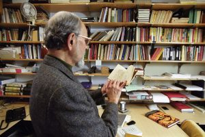 Muhammad Memon, professor of Urdu language and editor of the Annual of Urdu Studies, in his Van Hise office. Memon reads from the book Divan-e Ghalib, a collection of 19th century Persian poet Mirza Ghalib's poetry in Urdu. ©UW-Madison University Communications 608/262-0067 Photo by: Michael Forster Rothbart Date:  01/02     File#:   0201-05c-06