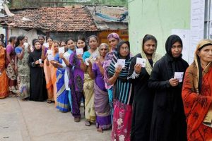 Women stand in queue to cast votes