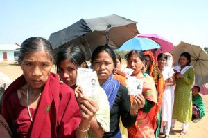 Tribal women Voters showing EPIC(elector's photo identity cards) at their hands standing in a large queue at a polling station under 11-Mandaibazar Assembly constituency in Tripura on February 23, 2008.