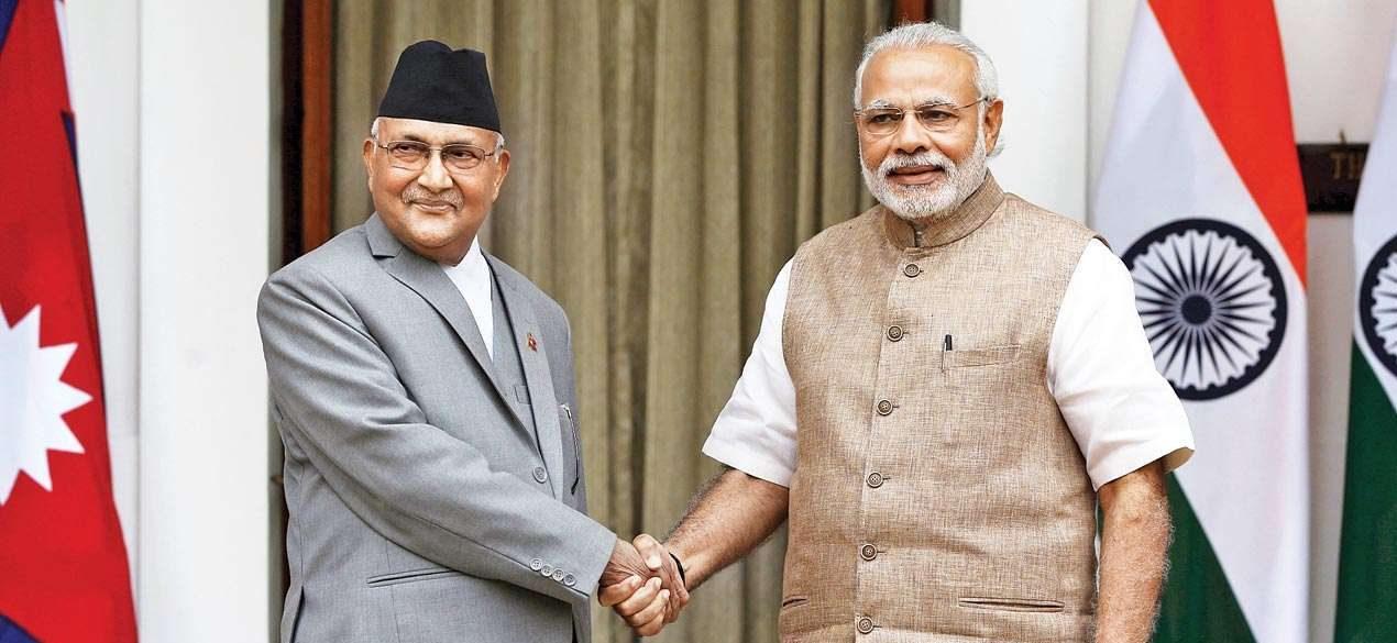 نیپال کے وزیر اعظم کے پی شرما اولی کے ساتھ وزیر اعظم نریندر مودی ، فوٹو: رائٹرس