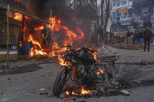 Kanpur: A vehicle torched allegedly by protestors during a demonstration against the Citizenship Amendment Act (CAA), in Kanpur, Saturday, Dec.21, 2019. (PTI Photo)