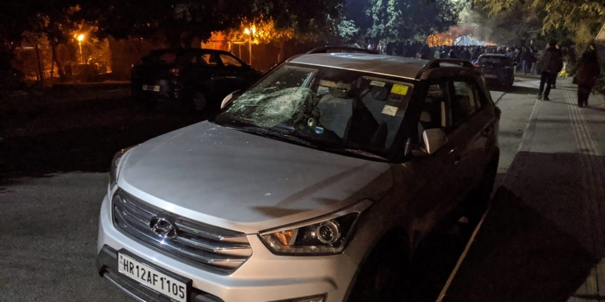 A car with its windscreen smashed inside JNU campus on Sunday night. Photo: Jahnavi Sen/The Wire