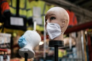 FILE PHOTO: A mannequin displays disposable face masks at a safety equipment store in the Brooklyn borough of New York City, U.S., March 26, 2020. REUTERS/Stephen Yang/File Photo