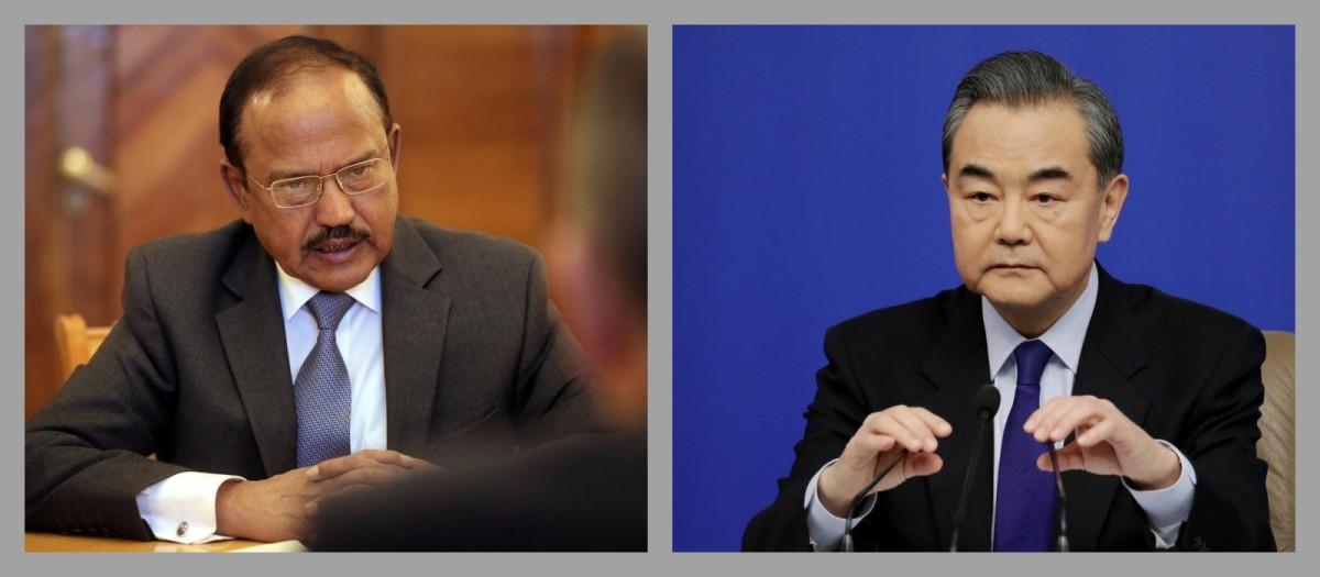 اجیت ڈوبھال اور چینی وزیر خارجہ۔ (فوٹو: رائٹرس)