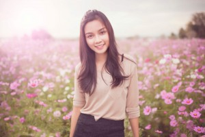 Acupuncture for Health-Young woman in field of flowers