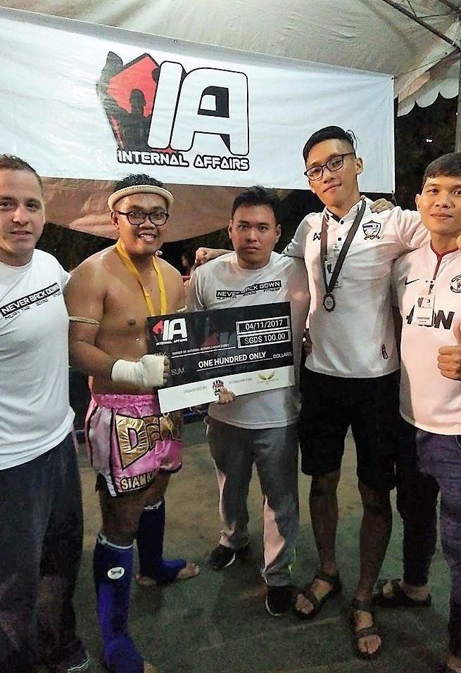 Denni Safiy (second from left) is flanked by his coaches and ring crew mates from Prime Fight Gym.