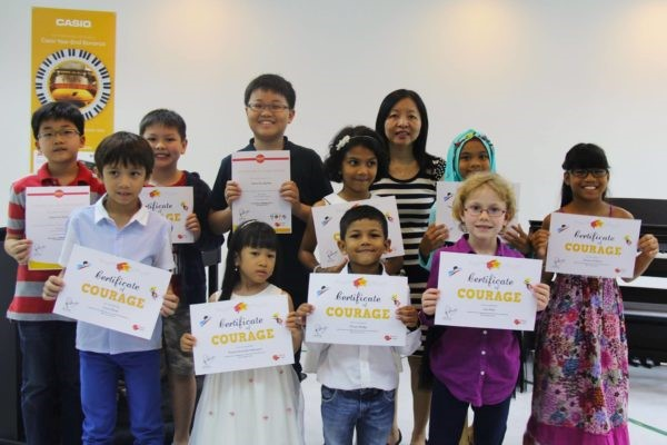 Children in Absolute Piano with their Certificates