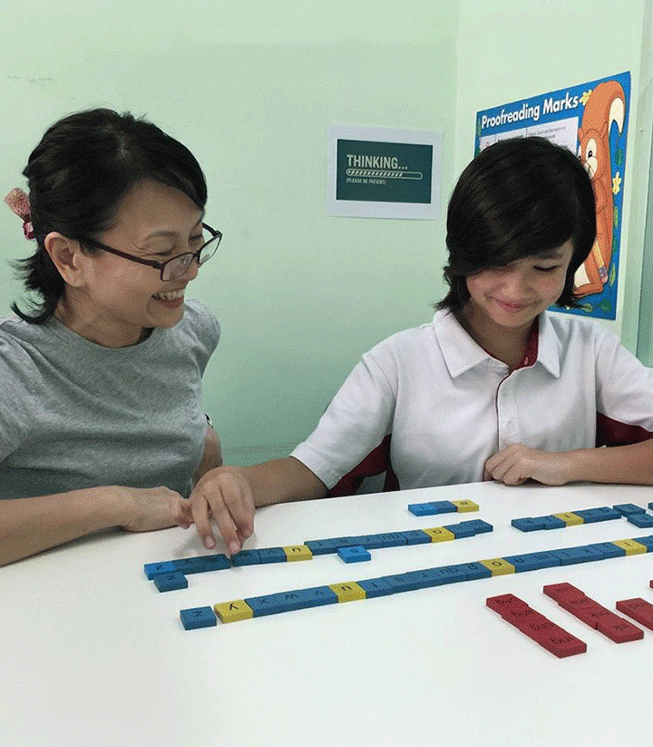 A student and her teacher in a Cognitive Connections class