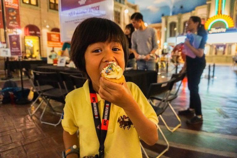 Child at KidZania enjoying her cupcake