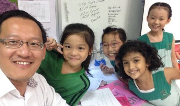 Mr. Chua and his students at Learning Corner