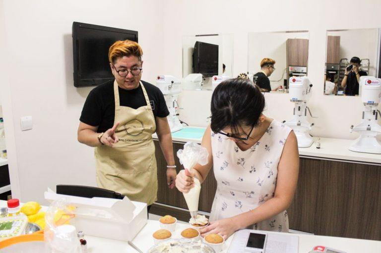 Matthew Shia teaching adult baking student