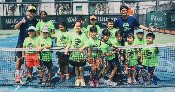 Students on a tennis court for a Whipper Tennis class