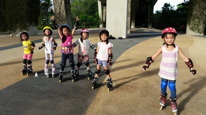 Children learning how to inline skate with iSkate