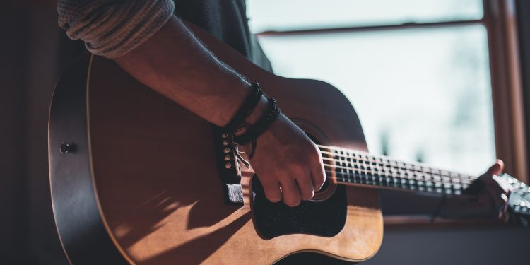 Guitar - Photo by Jacek Dylag on Unsplash