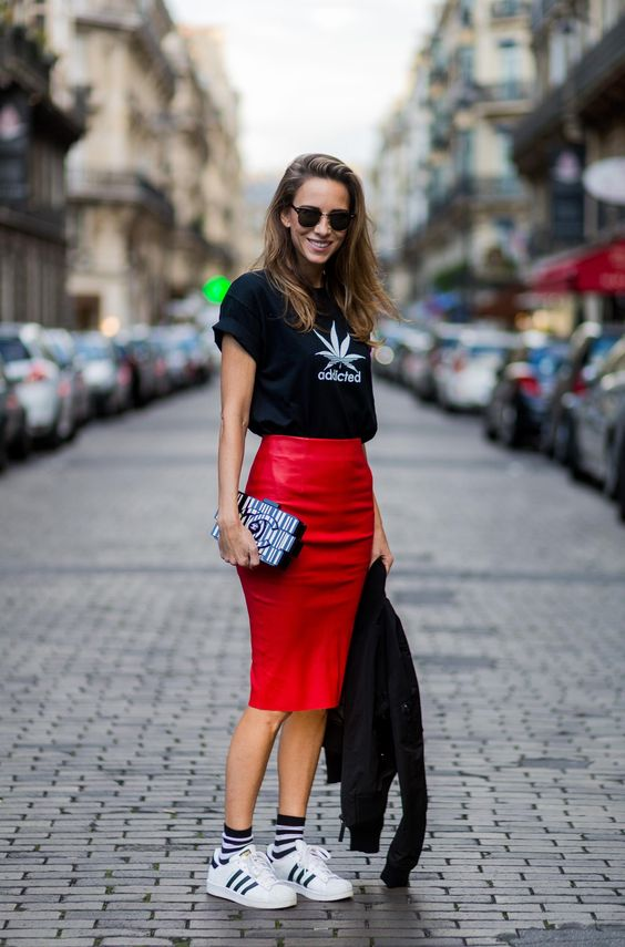 PARIS, FRANCE - OCTOBER 02: Fashion blogger and model Alexandra Lapp (@alexandralapp_) wearing a red pencil skirt from American Retro, Jerzees Addicted tshirt, Chanel bag, Addidas sneacker, H&M socks, Ray Ban sunglasses on October 2, 2016 in Paris, France. (Photo by Christian Vierig/Getty Images)