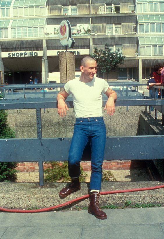 A teenage skinhead boy, wearing Doc Marten boots, Standing in the street, UK 1980's