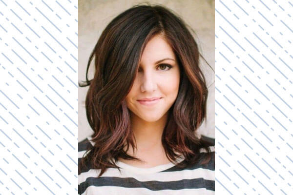 mid length with frayed ends hairstyle for women