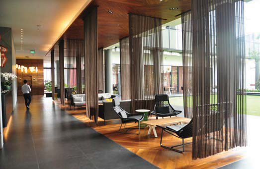 The hotel reception on the 12th floor, with a lounge overlooking the open-air sky garden. Source: Far East Organization - EDGEPROP SINGAPORE