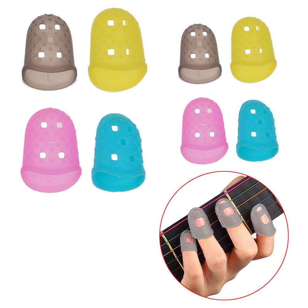 4pcs guitar fingertip protectors silicone finger guards guitar thumb picks ebay. Black Bedroom Furniture Sets. Home Design Ideas