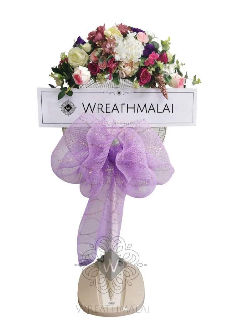 "WF018 พวงหรีด""ช่อม่วง"" SHARP/HATARI 16 นิ้ว/18 นิ้ว เกลียวโบว์สีม่วง + ดอกไม้สีพาสเทลจัดช่อสวยงามด้านบน"