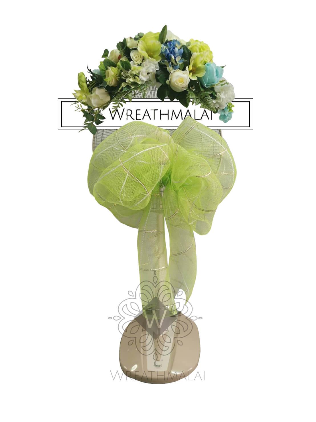 """WF022 พวงหรีด """"หยกมณี""""  SHARP/HATARI 16 นิ้ว/18 นิ้ว เกลียวโบว์เขียวอ่อน และดอกไม้พาสเทลจัดช่อสวยงามด้านบน"""