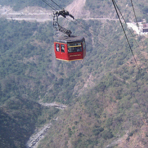 Get into an Exciting Cable Car Ride over the Dhuandhar Falls